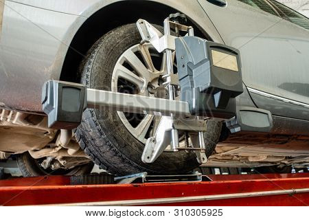 Wheel Alignment Equipment In Use In Tyre Depot Or Garage