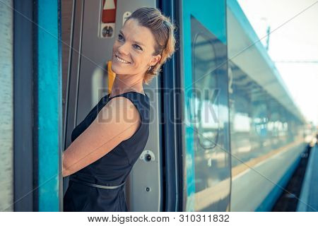 Young Attractive Woman Bussinessman Says Goodbye To A Boarder On Train Train. He Enters The Internat