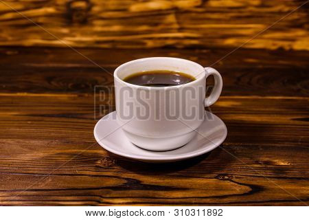 Cup Of Dark Coffee On Rustic Wooden Table