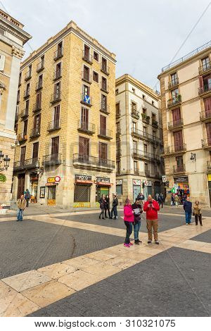 Barcelona, Spain- 09 November 2014: Tourists In The Middle Of The De Sant Jaume Square At The Center