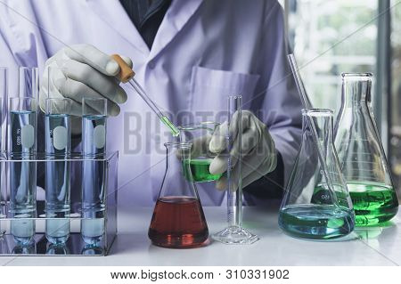 Researcher With Glass Laboratory Chemical Test Tubes With Liquid For Analytical , Medical, Pharmaceu
