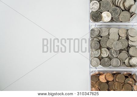 Organized Loose Coin Change On Right Side, Blank Empty Room Space For Text Left