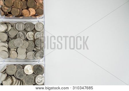 Organized Loose Coin Change On Left Side, Blank Empty Room Space For Text Right