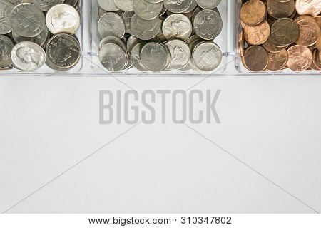 Organized Loose Coin Change On Top Side, Blank Empty Room Space For Text Bottom