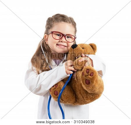 Little Cute Girl In Doctor Costume Holding Sthetoscope On Chalkboard