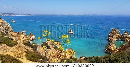 Beautiful Landscape: Cliffs In Turquoise Atlantic Ocean Near Lagos, Portugal