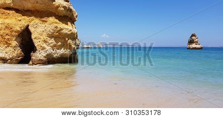 Beautiful Landscape: Cliffs In Turquoise Atlantic Ocean On The Beach Praia Dona Ana, Lagos, Portugal