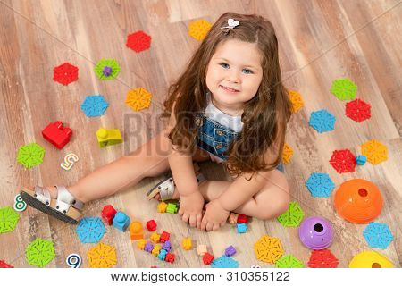 Little Child Playing With Toys. Toys For Kids.
