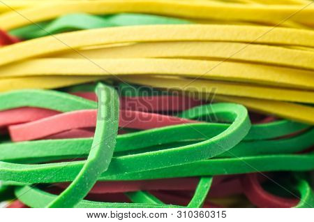 Macrophotography Of Rubber Bands In Yellow, Green And Red Color