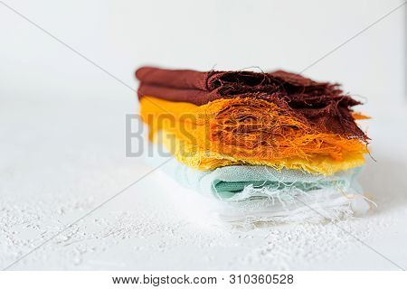 Pile Of Colorful Textile Swatches On White Background
