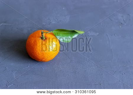 Fresh Tangerines With Leaves On Black Stone Background. Top View. Copy Space.