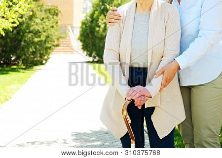 Senior Woman In Park On Sunny Day.