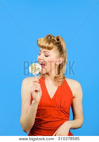 Satisfed Woman Eating Piece Of Candy. Sexy Blonde Girl Licking Lollipop. Beautiful Woman With Fashio