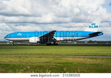 Klm Boeing 777-200 Ph-bqp Passenger Plane Departure At Amsterdam Schipol Airport