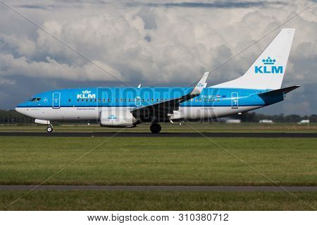 Klm Boeing 737-700 Ph-bgi Passenger Plane Departure At Amsterdam Schipol Airport