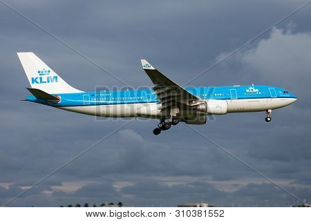 Klm Airbus A330-200 Ph-aoe Passenger Plane Landing At Amsterdam Schipol Airport