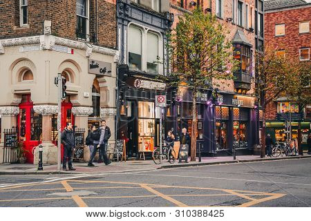 Dublin, Ireland - November 8, 2018: Old City With Vintage Cafe, Shops Storefronts And Walking People