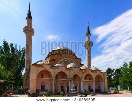 Yevpatoria, Crimea - July 08, 2019. The Juma-Jami Mosque, largest mosque of Crimea, is located in Yevpatoria, Crimea. Built between 1552 and 1564, and designed by the Ottoman architect Mimar Sinan.