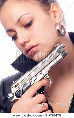 Beautiful girl in black leather jacket and beretta gun in her hand isolated on white background