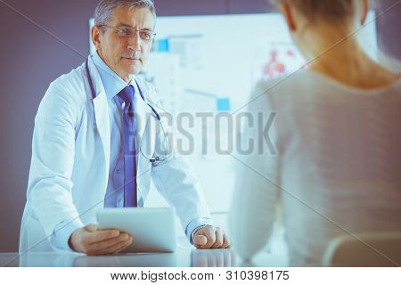 Doctor man with patient in medical office
