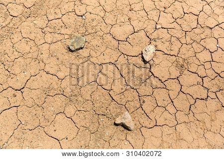 Parched And Dead Cracked Mud In The Desert