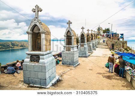 Copacabana, Bolivia-Jan 4, 2019: Religious procession on Cerro Calvario (Calvalry Hill) on lake Titicaca in Copacabana, Bolivia