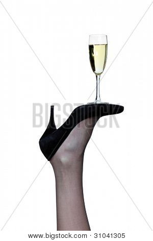 flute of champagne posed on sole of pump