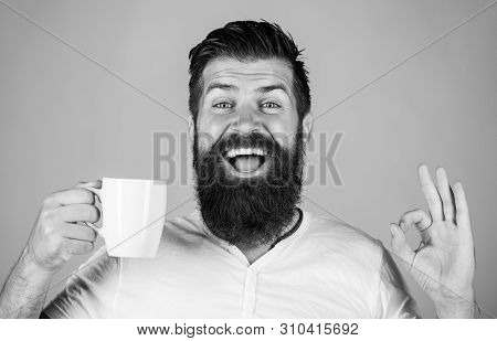 Bearded Man Smiling Showing Sign Ok. Good Morning, Man Tea, Ok. Smiling Hipster Man With Cup Of Fres