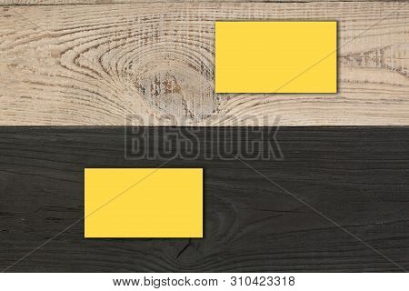 Mockup Of Horizontal Gold Business Cards Stacks Arranged In Rows At Wooden Background.