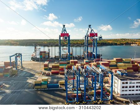Aerial View Of Container Terminal Pier During The Containership Loading Process. Container Ship In I
