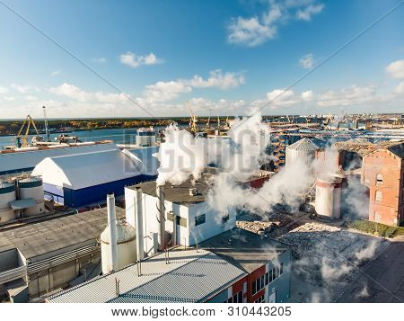 Aerial View Of Paper And Wood Industry Company Building Complex During Operational Process Resulting