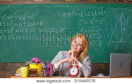 Take Your Time. Teacher With Alarm Clock At Blackboard. Time. Study And Education. Modern School. Kn