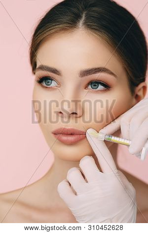 Womans Plumper Lips, Getting Bigger Lips. Prick Of A Syringe For The Lips. Injections For Bigger Vol