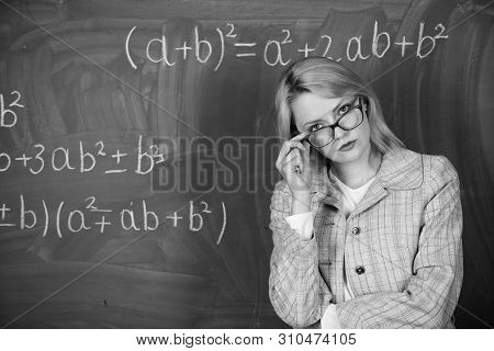 Teacher On School Lesson At Blackboard. Woman In Classroom. School. Home Schooling. Serious Woman. B