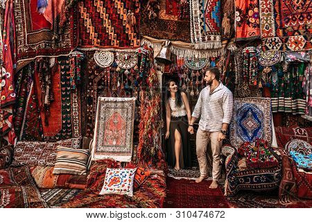 Man And Woman In The Store. Couple In Love In Turkey. Man And Woman In The Eastern Country. Happy Co