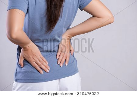 Close Up Woman Having Pain In Injured Back. Healthcare And Back Pain Concept.