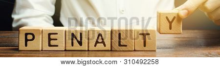 A Man Puts A Wooden Blocks With The Word Penalty. Fine As A Punishment For A Crime And Offense. Viol