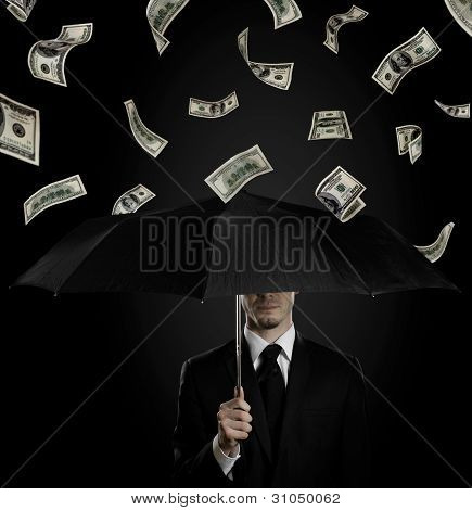 man in black costume with blak umbrella under rain of currency note concept economics crisis poster