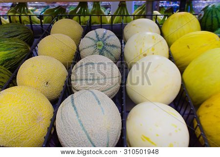 Muskmelon In Different Size And Colors Sold In The Store