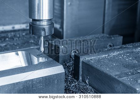 The Cnc Milling Machine Drilling The Centre Drill At The Mould Parts. The Injection Mould Manufactur