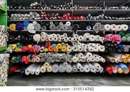 Fabric Warehouse With Many Multicolored Textile Rolls