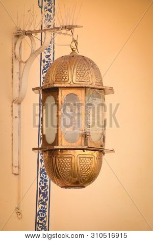 Udaipur, Rajasthan, India - 8 July 2019: Abstract Background Of Gold Vintage Lamp, Lantern Hanging O