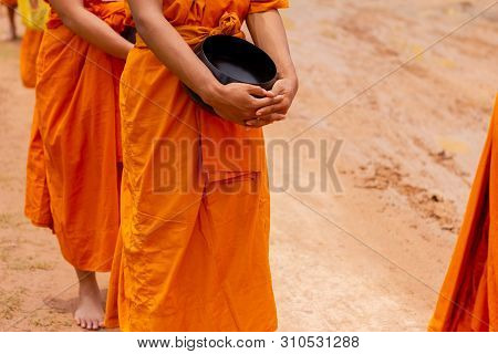 There was a merit making in the morning. People would scoop food into the alms of many monks. poster