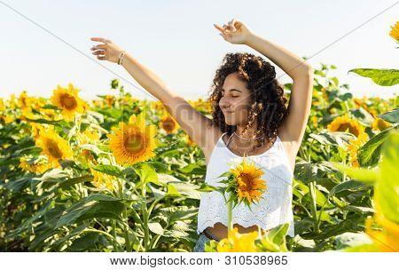 Teenager Girl In Sunflowers Field