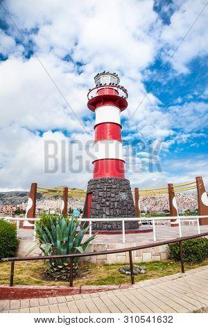 Puno, Peru-Jan 5, 2019: Lighthouse in a port of Puno, Peru. South America