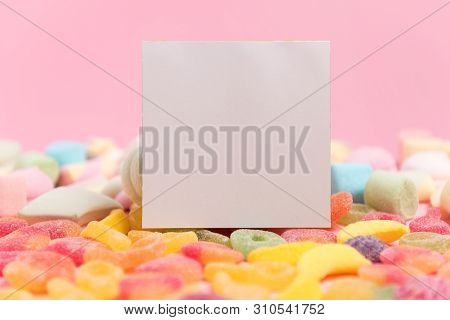 Pink paper background with sugary jellies and blank notepad. Place for your text. Cozy sweet background poster