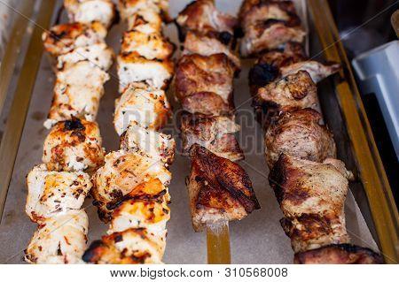 Meat Skewer. Skewers On Skewers. Pork Cooked On The Fire. Ate The Grill. Street Freshly Prepared Foo
