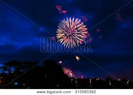 Inexpensive Fireworks, Over The City Sky, Red And Pink With Smoke. For Any Purpose Use.