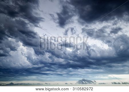 Background of dark stormy sky at summer evening. Dramatic skyscape with large gray clouds. Different cloud types and atmospheric phenomena. poster
