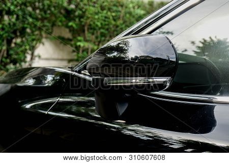 Close Up Wing Left Mirror Of The Black Luxury Car